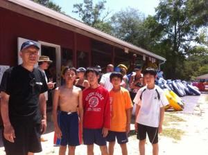Japanese Coach with the boys on the team